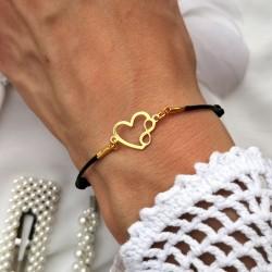 Złote serce na czarnym sznurku